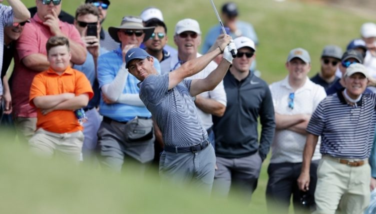 Rory McIlroy keeps hopes alive as Dustin Johnson out of Match Play