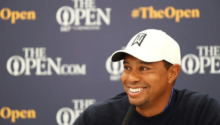 Tiger Woods: All smiles