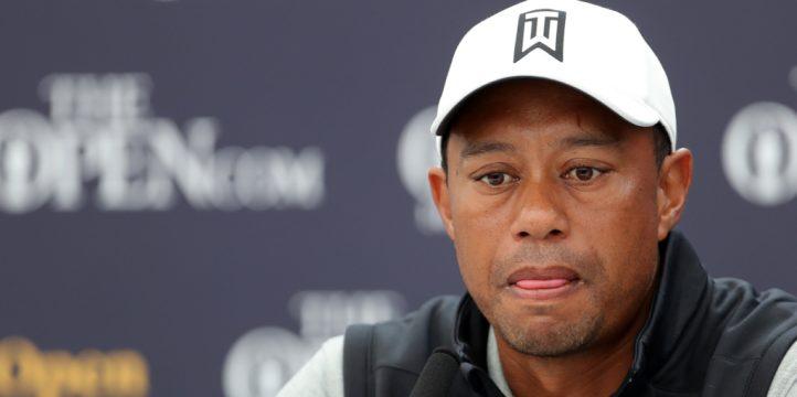 Tiger Woods talking to press