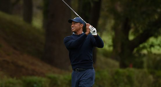 Tiger Woods pitching in Japan