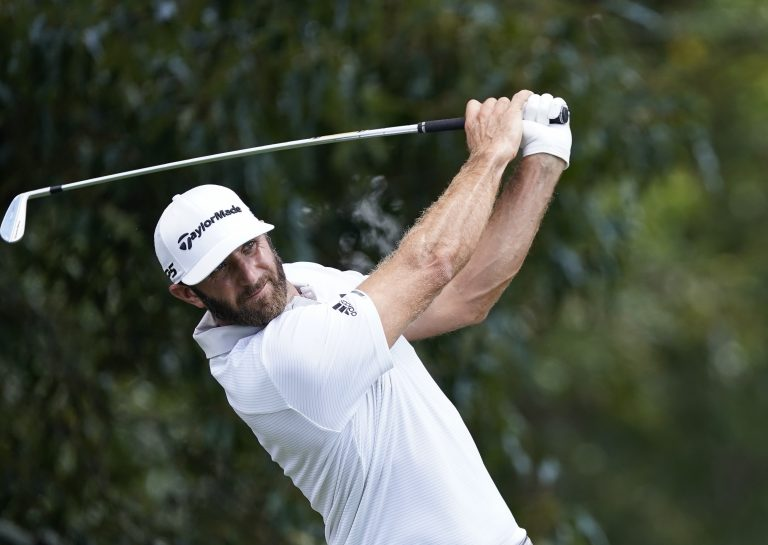 World number one Dustin Johnson kept himself in contention after a difficult round in Atlanta
