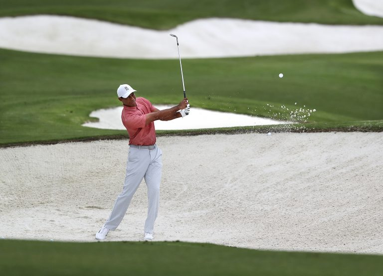 Tiger Woods practices on his sand shots on the practice range at Augusta National