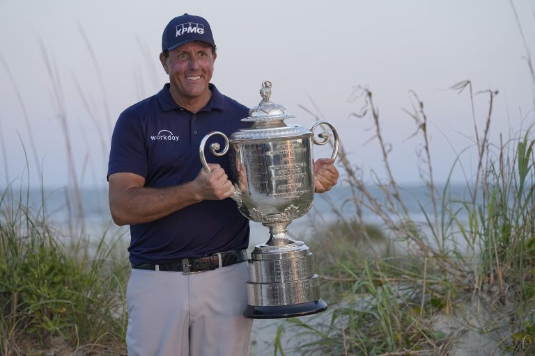 Phil Mickelson holds the Wanamaker Trophy after winning the US PGA Championship
