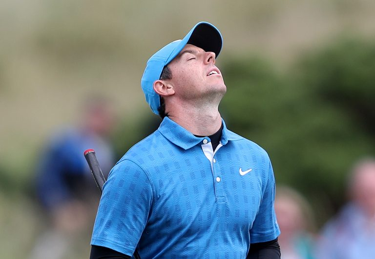 Rory McIlroy closes his eyes in frustration