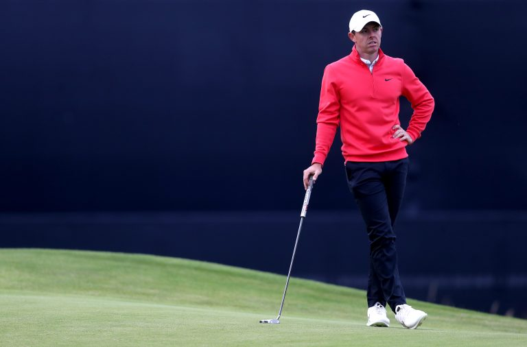 Rory McIlroy leans on his putter