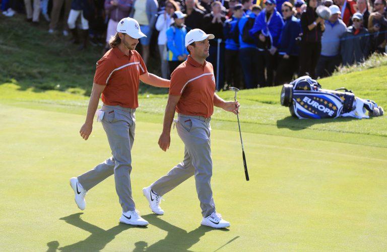 Tommy Fleetwood and Francesco Molinari walk off a green together